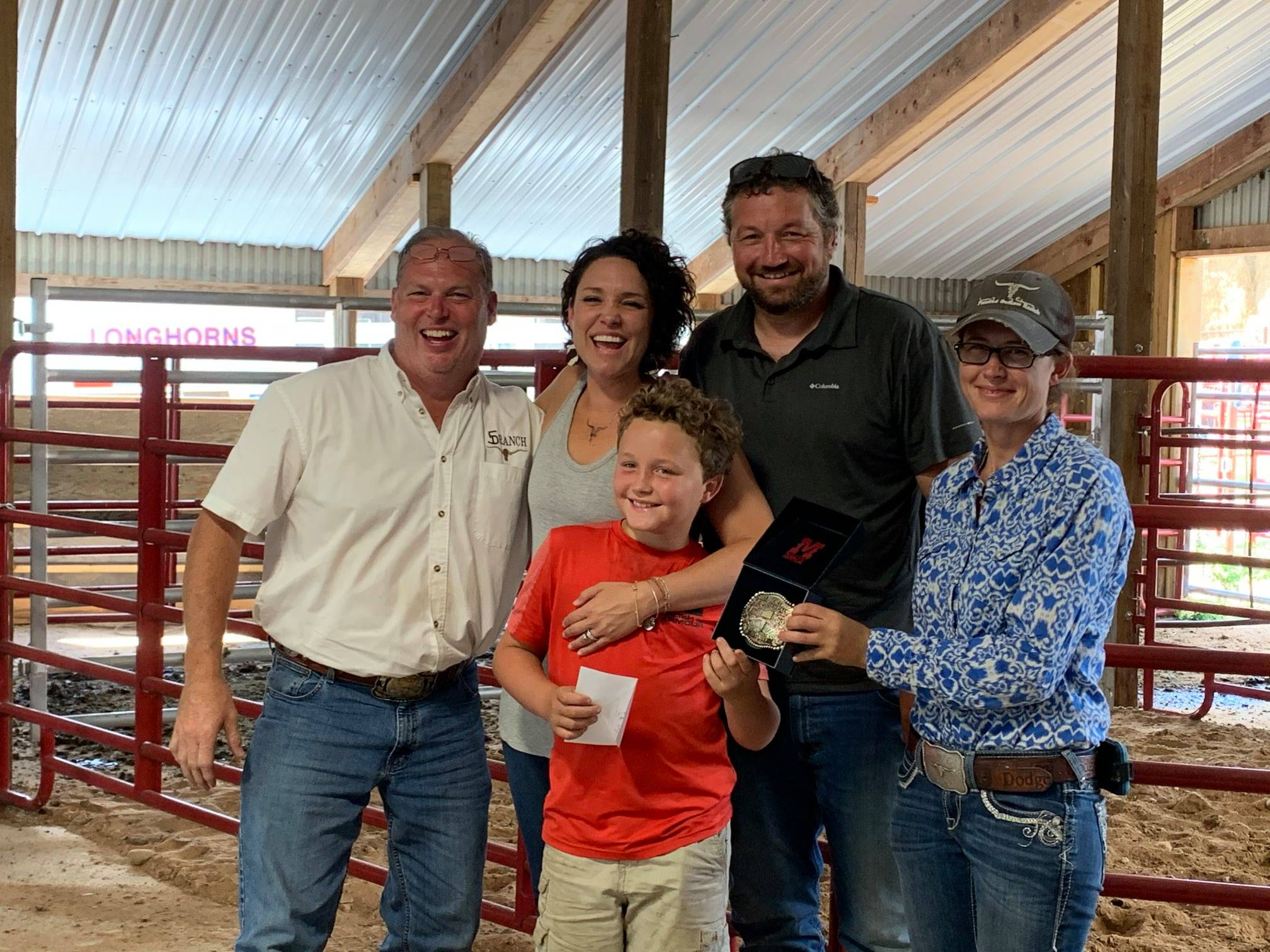 Futurity class winner and Hired Hand customers David & Angie Wulf, 4 Oaks Farm with Sale Host and Hired Hand Customer Dan Huntington, 5D Ranch