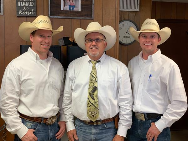 Auctioneer Joel Lemley with Ringmen Troy Robinett and Logan Harke