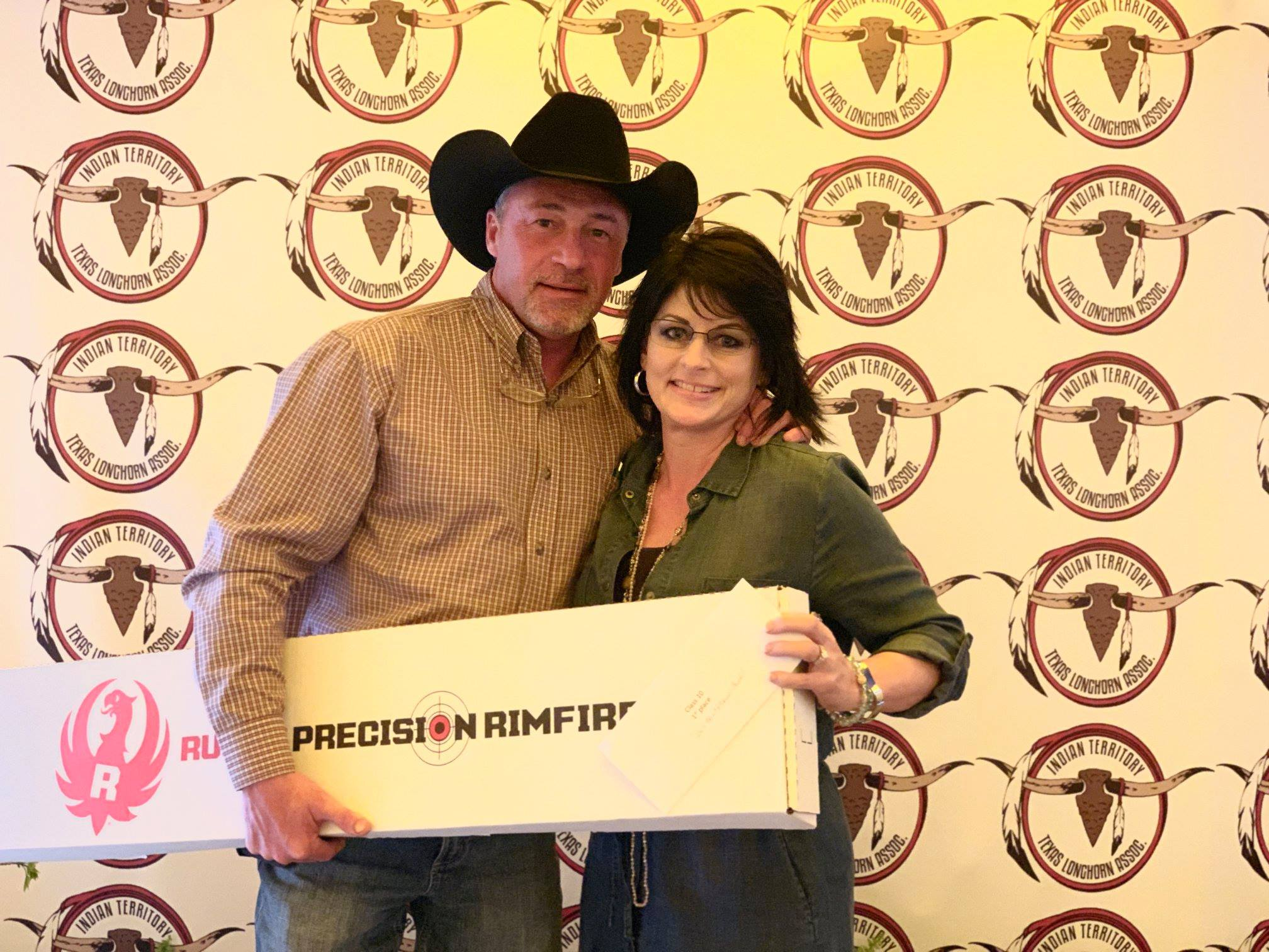 Hired Hand customers, Futurity Winners and Sale Hosts Dale Hunt and Sherrill Caddel with Rockin H Longhrons