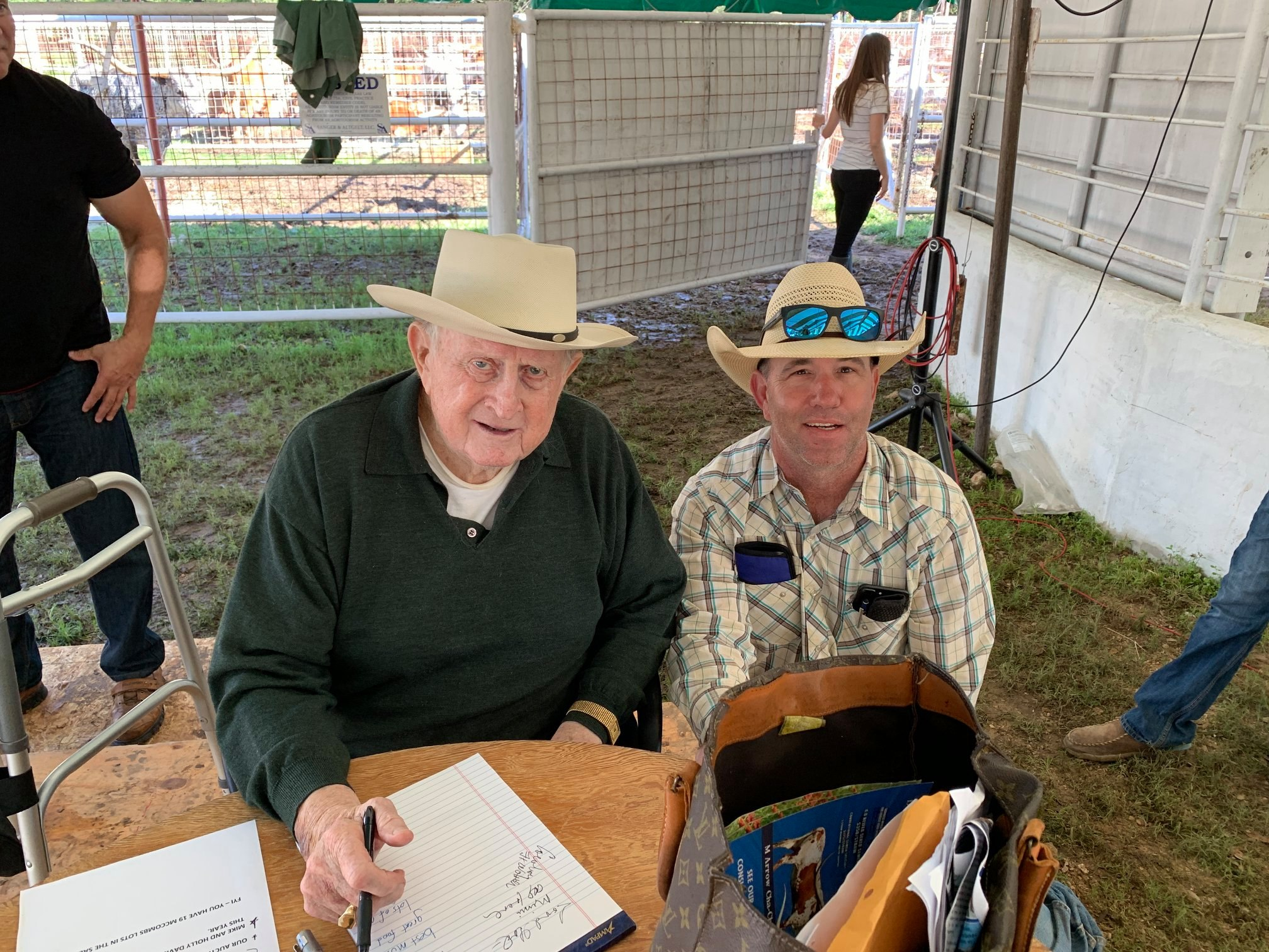 Red McCombs and ranch hand Chad